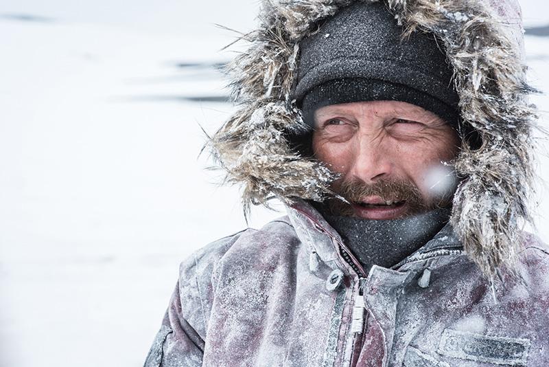 Mads Mikkelsen stars as Overgård in ARCTIC, a Bleecker Street release. Credit: Helen Sloan SMPSP / Bleecker Street