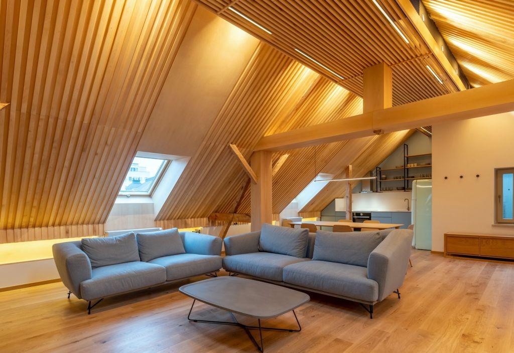 Influenţe Art Deco reinterpretate în lemn pentru o mansardă scenografică